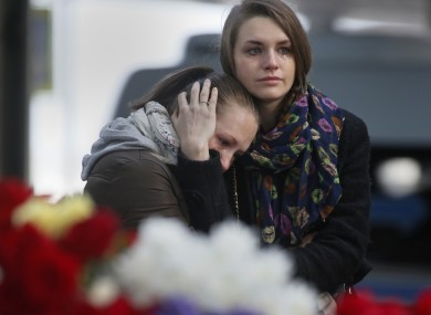 Young women grieve at an entrance of Pulkovo airport outside St.Petersburg, Russia