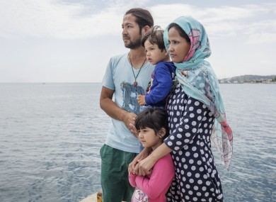 """An Afghan family at the pier on the island of Kos. """"I've come to Europe to give my children the best."""""""
