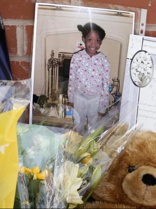 A photograph  of Semelia Campbell amongst flowers where she was killed.