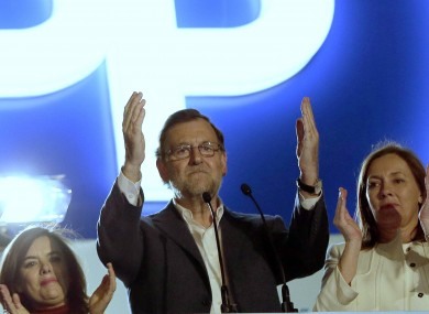 Popular Party leader and current Prime Minister Mariano Rajoy greets supporters.