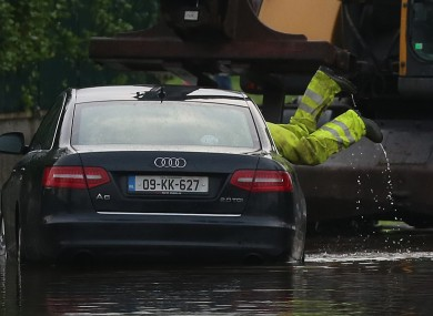 Emergency workers remove a car in the area of Corbally in Limerick yesterday.