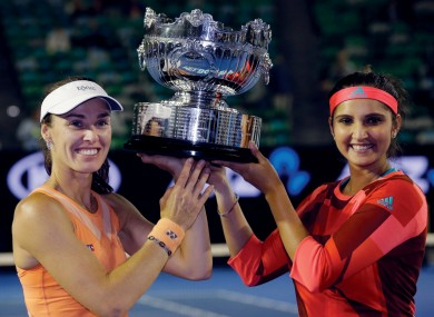Martina Hingis with her partner Sania Mirza after victory this morning.