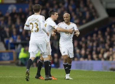Swansea City's Andre Ayew, right, celebrates with teammates after scoring.