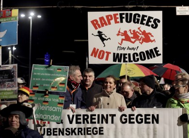Protesters pictured in Leipzig yesterday