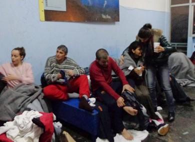 Survivors change clothes at Kalymnos island.
