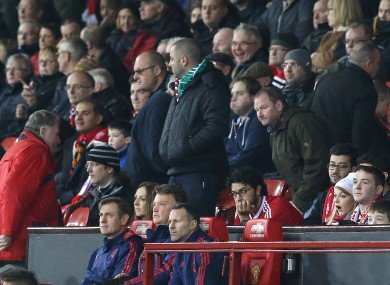 Manchester United manager Louis van Gaal looks on as fans leaves their seats at Old Trafford.