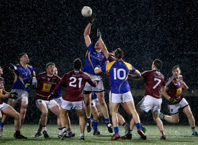 Longford's Michael Brady rises highest amongst a group of players at St Loman's.