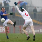 Rory Brennan gets a block in on Cavan's Martin Reilly.<span class=