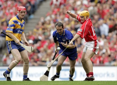 Brian Lohan and Davy Fitzgerald in action for Clare against Cork's Joe Deane.