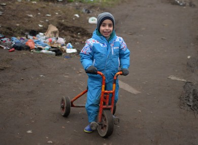 A child on a tricycle pictured in the Jungle refugee camp earlier this month.
