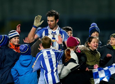 Michael Darragh MacAuley of Ballyboden celebrates with supporters at the end of the game.