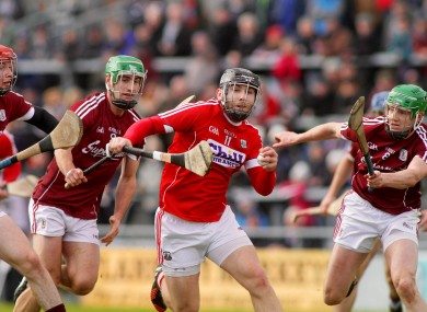 Cork's Paudie O'Sullivan with Padraig Mannion and Adrian Tuohy of Galway.