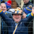 A Roscommon fan celebrates victory over Kerry.<span class=