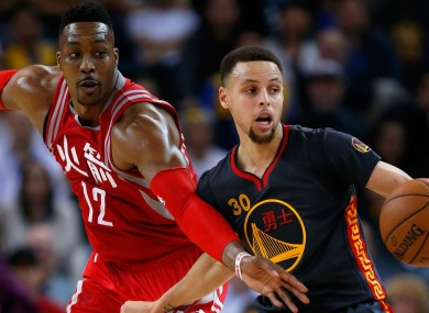 Stephen Curry and Dwight Howard during last night's game.