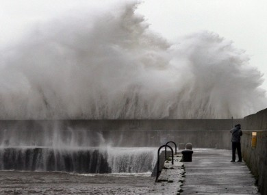 Stefano Fedele from Italy takes a closer look at the massive waves created by Storm Frank's gale force winds at Bray Harbour on New Year's Day.