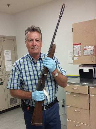 Detective Michael Ciesynski holds the shotgun which rock legend Kurt Cobain used to take his own life in 1994.