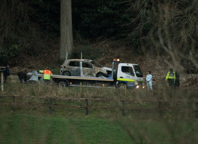 A burnt out car is removed from the scene at Ravensdale Park in March 2012