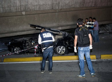 A car crushed underneath a collapsed underpass