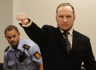 Anders Behring Breivik makes a fascist salute after arriving in court in 2012. (File)