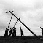 Erecting the poles, one at at time<span class=