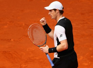 Andy Murray celebrates winning a point in his meeting with Rafael Nadal in Madrid