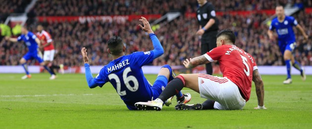 Leicester's Riyad Mahrez, centre left, appeals for a penalty after a tackle by Manchester United's Marcos Rojo.
