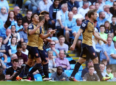 Alexis Sanchez (left) celebrates the goal that could cost City a fortune.