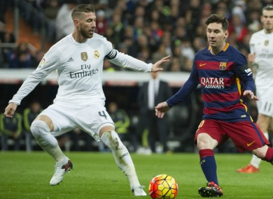 Sergio Ramos attempts to stop Lionel Messi