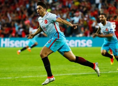 Ozan Tufan celebrates Turkey's second goal.