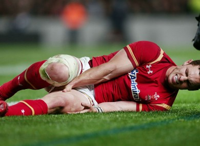 Wales wing George North clutches his injured hamstring