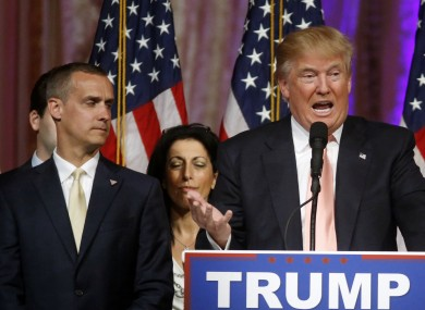 Corey Lewandowski stands alongside Trump at an election night event in Florida in March.