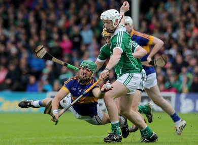Tipperary's James Barry grabs the sliothar under pressure from Limerick's Cian Lynch.