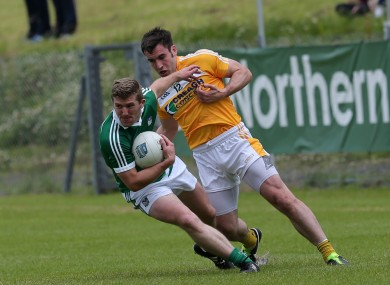 Limerick's Johnny McCarthy and Antrim's Kevin Niblock