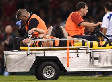 Leigh Halfpenny leaving the field on a stretcher during Wales' World Cup warm-up match against Italy last September.