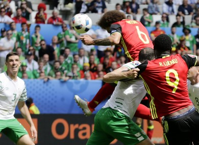 Belgium's Axel Witsel, top, scores on a header his side's second goal.