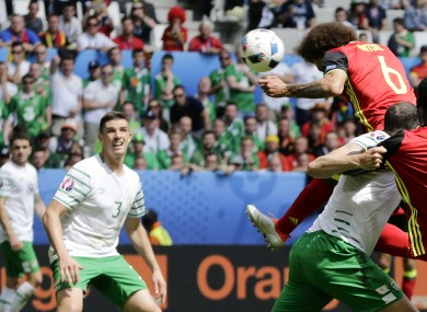 Belgium's Axel Witsel, top, scores on a header his side's second goal during the Euro 2016 Group E match between Belgium and Ireland.