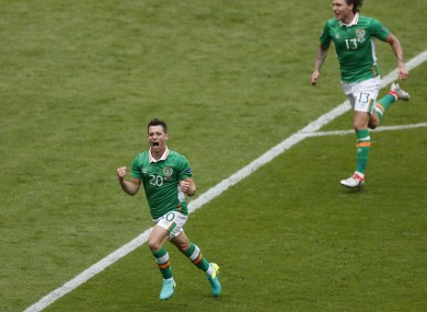 Wes Hoolahan celebrates after scoring the opening goal during the Euro 2016 Group E soccer match between Ireland and Sweden.