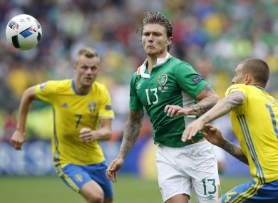 Ireland's Jeff Hendrick, centre, and Sweden's Victor Lindelof, right, go for the ball during the Euro 2016 Group E soccer match.