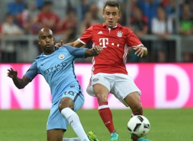 Fabian Delph (left) has been impressed by Guardiola's immediate impact.