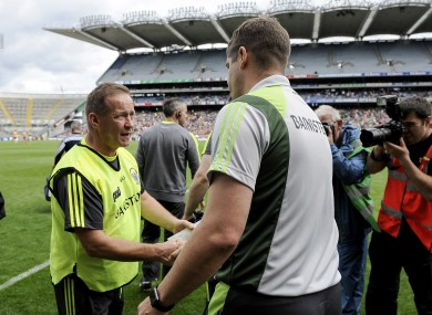 Clare boss Colm Collins and Kerry manager Eamonn Fitzmaurice shake hands after the game.