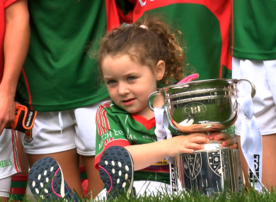 A young supporter gets her hands on the trophy.
