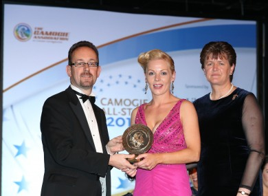 Loughlin (centre) receiving her Soaring Stars Award at the camogie All-Stars in 2014.