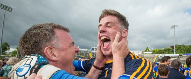 Tipperary manager Liam Kearns celebrates with goalkeeper Evan Comerford.