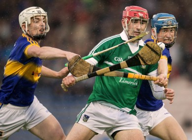 Limerick's Barry Nash in action against Tipperary's Ronan Maher.