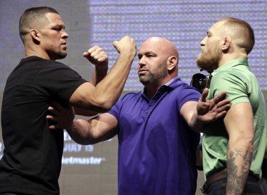 UFC president Dana White keeps Nate Diaz and Conor McGregor apart at the conclusion of the UFC 202 press conference.