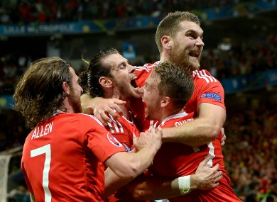 Wales' Sam Vokes (right) celebrates scoring his side's thrid goal of the game.