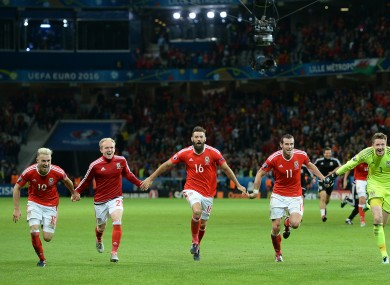 The Welsh players celebrate their victory.