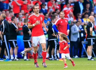 Wales' Gareth Bale and his daughter Alba Violet on the pitch after the final whistle against Northern Ireland.