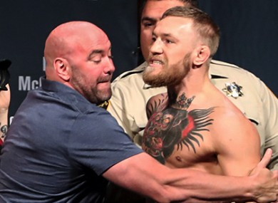 Dana White restrains Conor McGregor during last Friday's UFC 202 weigh-ins.