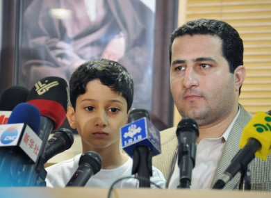 Iranian scientist Shahram Amiri (R), who went missing in 2009, attends a press conference with his son next to him, at Imam Khomeini International Airport in Iran in 2010.